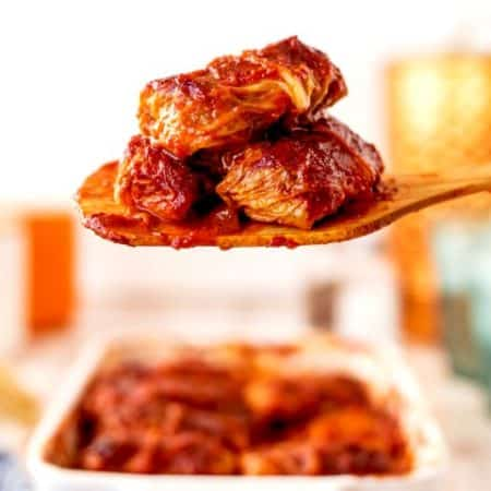Cabbage Rolls on a wooden serving spoon