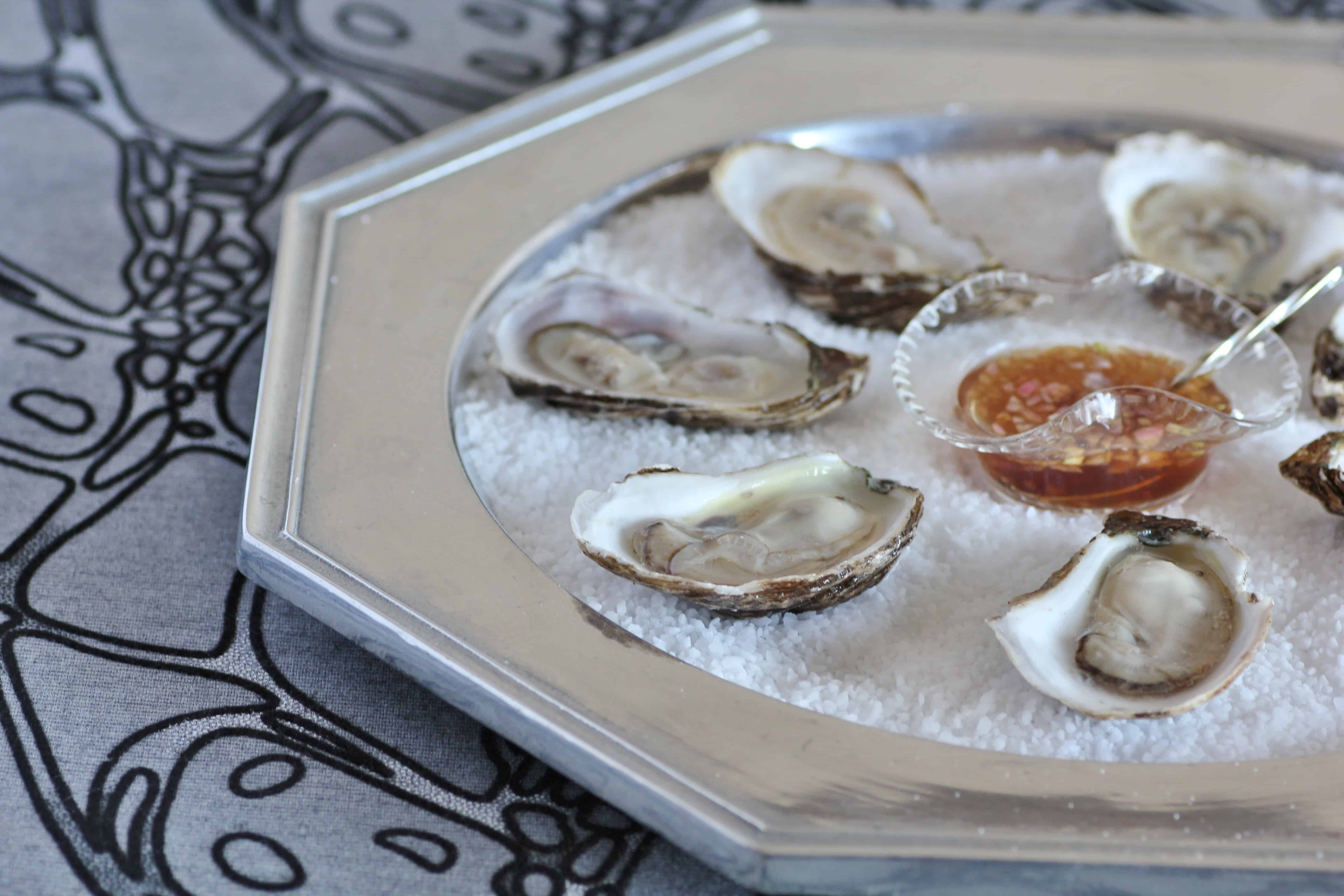 ... immediately with the mignonette sauce hot sauce and lemon wedges enjoy