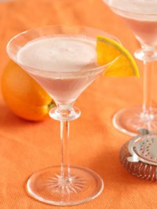 creamsicle cocktail in a martini glass