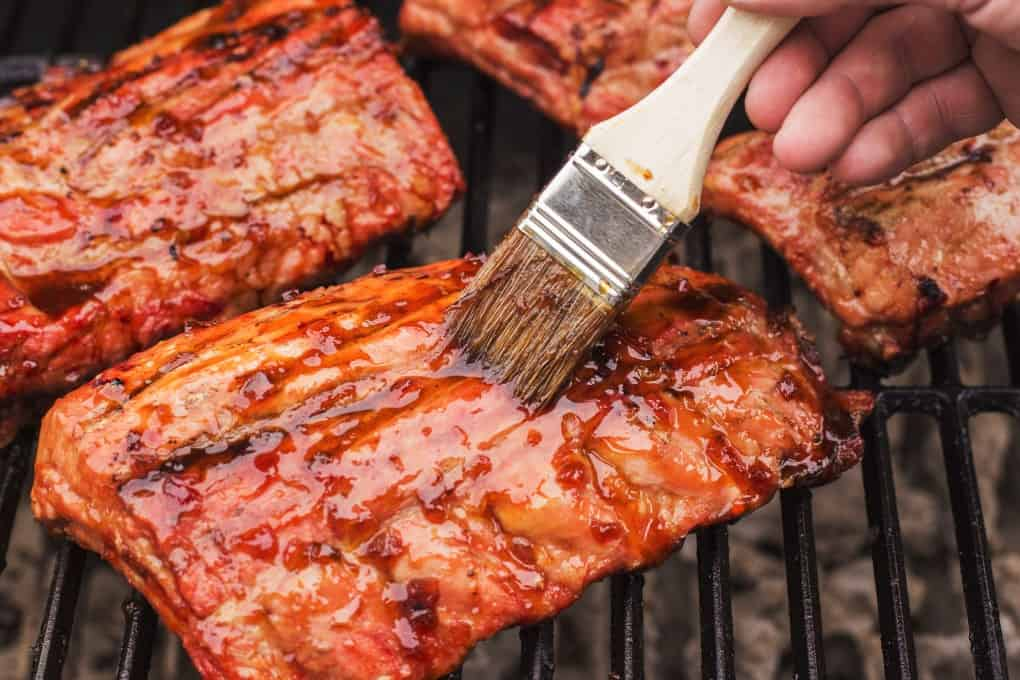 Ribs on the BBQ being glazed