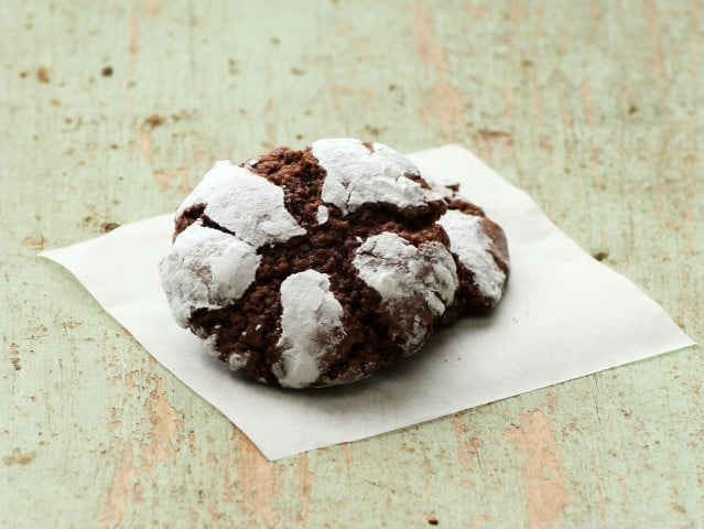 2 Chocolate Crinkles cookies on a white napkin