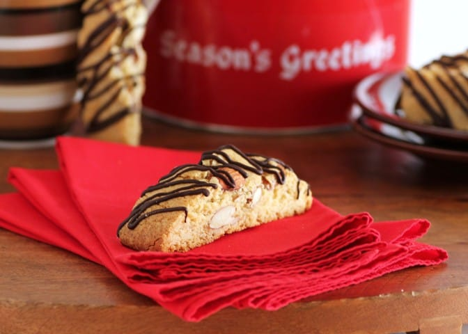 1 piece of Amaretto Almond Biscotti on a stack of red napkins