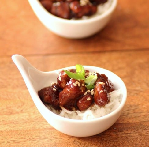 Pork Tenderlin Tid Bits over rice in a small white individual serving bowl