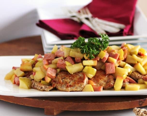 Michael Symon's Pork and Apple Scallopini on a white serving platter