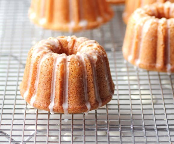 Mini Orange Bundts with a Grand Marnier Glaze on a wire cooling rack