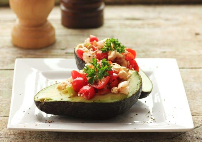 Tomato Avocado Boats on a white plate
