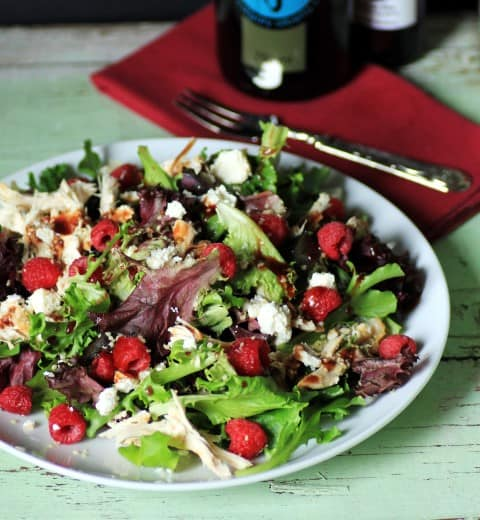 Raspberry, Chicken and Feta  and hemp Salad on a white plate