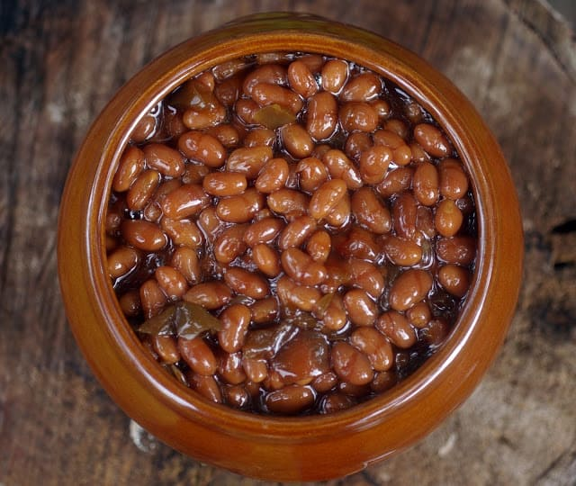 Baked Beans in a large brown ceramic bowl