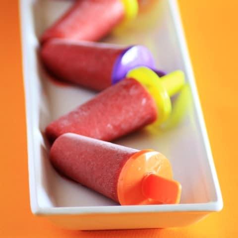 Strawberry Lime Ice Pops  on a white recangle platter