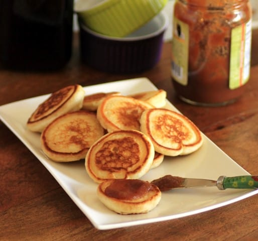 Mini Griddle Cakes on a white plate with apple butter
