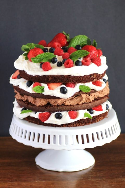 Whipped Cream Berry Layer Cake on a white cake stand