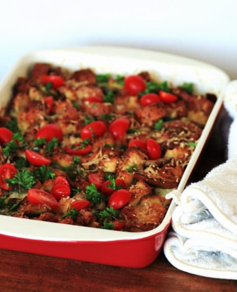 Gluten Free Savory Bread Pudding in a red and white casserole dish