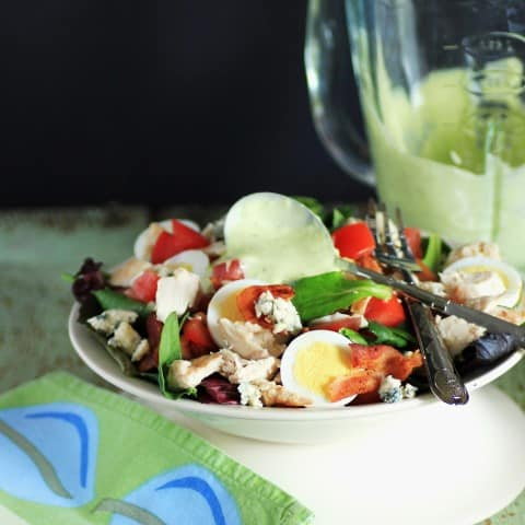 Wendy's Chicken BLT Cobb Salad in a white bowl with a fork and green cloth napkin