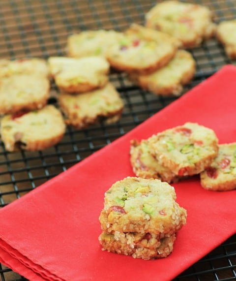 Cherry Pistachio Ice Box Cookies on a red napkin on a cooling rack