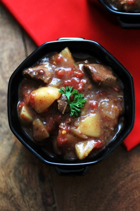 Excellent Beef Stew in a black bowl with a red napkin