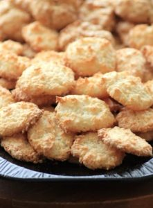 Golden Coconut Macaroon cookies stacked on a serving platter