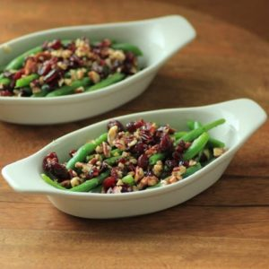 Green Beans with Pecans and Cranberries in oval serving dishes