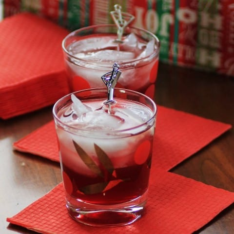2 Cherry Noir Noel Cocktails on red coasters in old fashion glasses