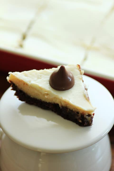 Coffee Mocha Cheesecake Diamond on a white plate with a Hershey Kiss on top