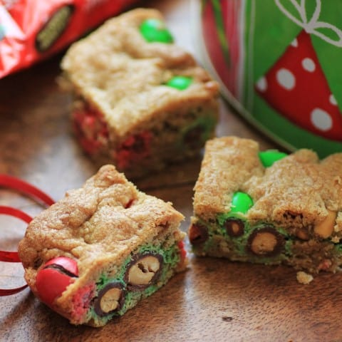Holiday Cookie Bars squares on a wooden board