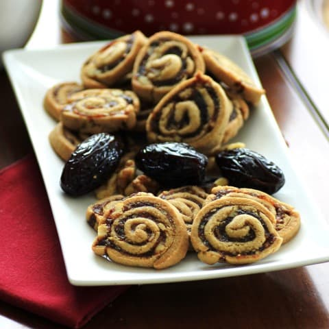 Swirl Cookies on a white rectangle plate with dates
