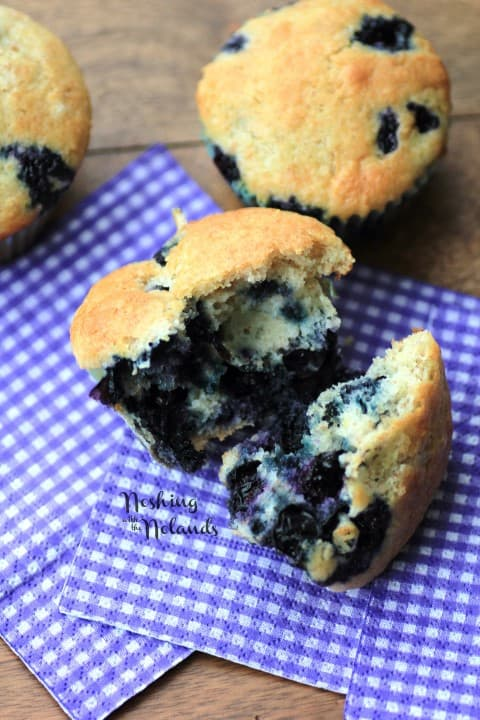 Blueberry Muffin on a purple and white napkin broken in half
