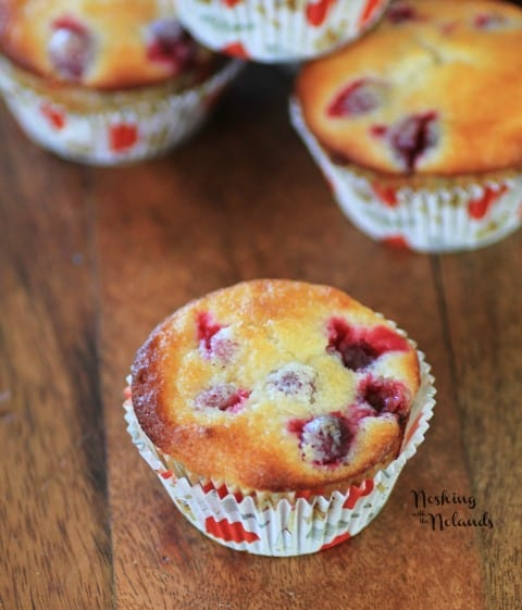 Cranberry Lemon Almond Muffins on a wooden cutting board