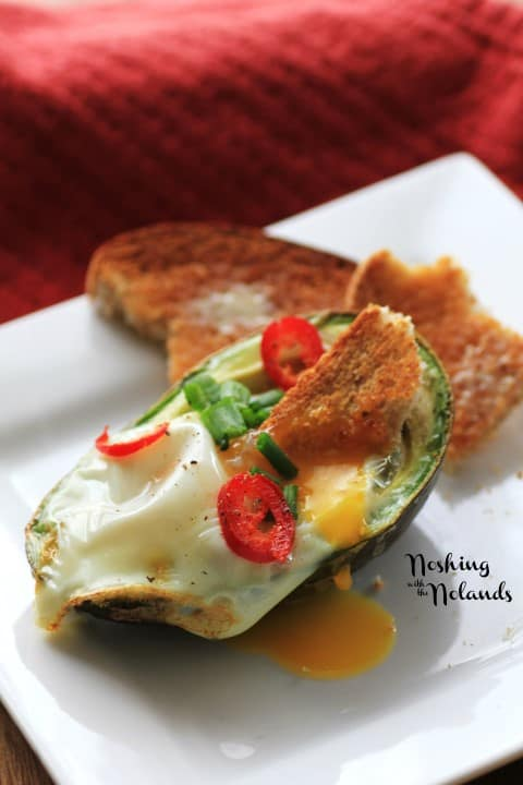 Eggs in Avocados by Noshing With The Nolands