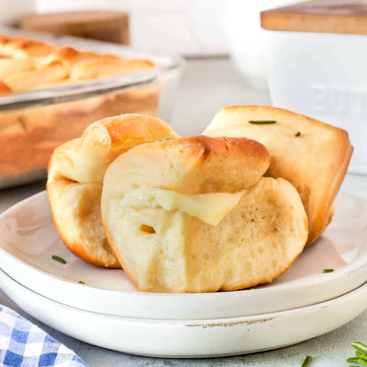 Closeup of Parker House Rolls on a plate with butter