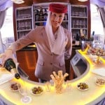 Emirates-A380-Cabin-Crew-serving-champagne-in-Onboard-Lounge-990x500-1