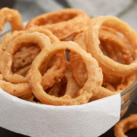 Beer Battered Onion Rings in a white bowl