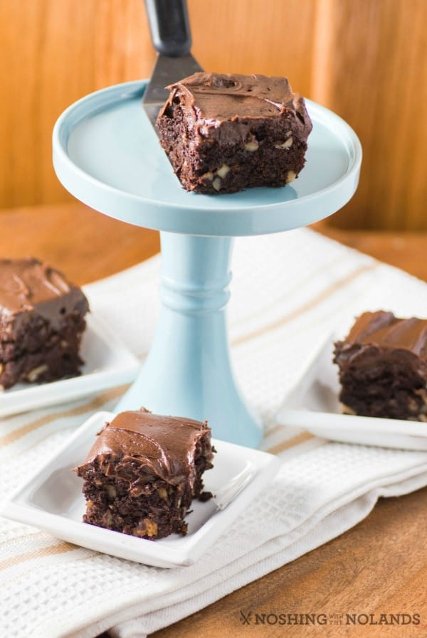 Brownie on a pedestal with other brownies around it.