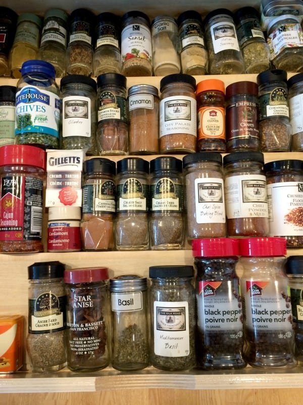 Spice drawer organization using ShelfGenie custom Solutions for existing cabinets