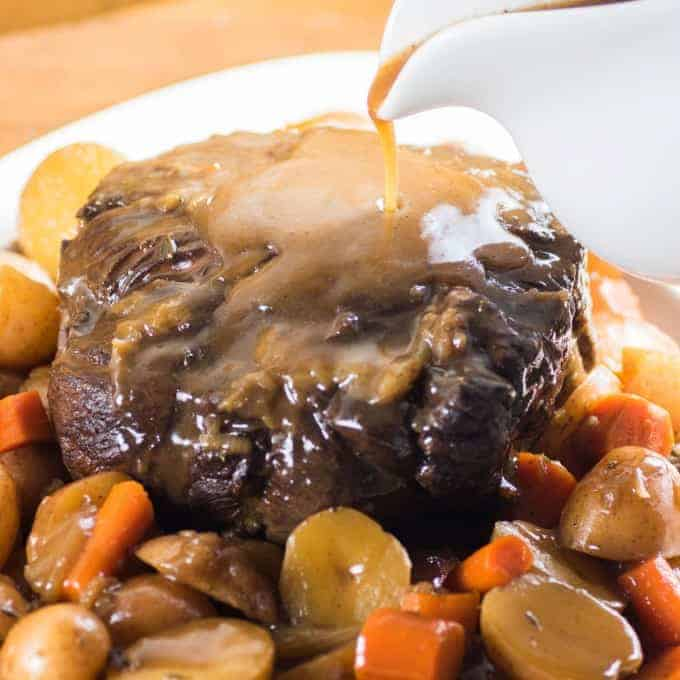 Pressure Cooker Roast Beef with gravy being poured on top
