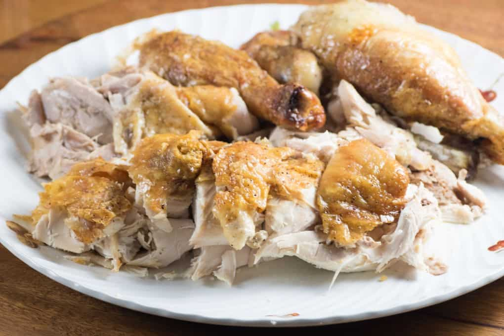 Roast chicken carved up on a platter