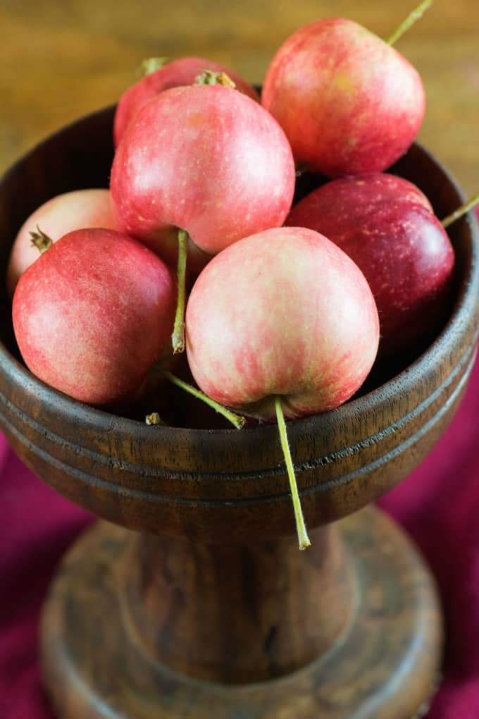 Crabapples in a wooden bowl