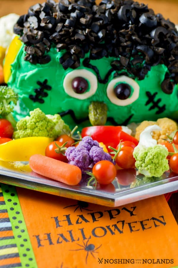 Frankenstein cheese ball head with vegetables