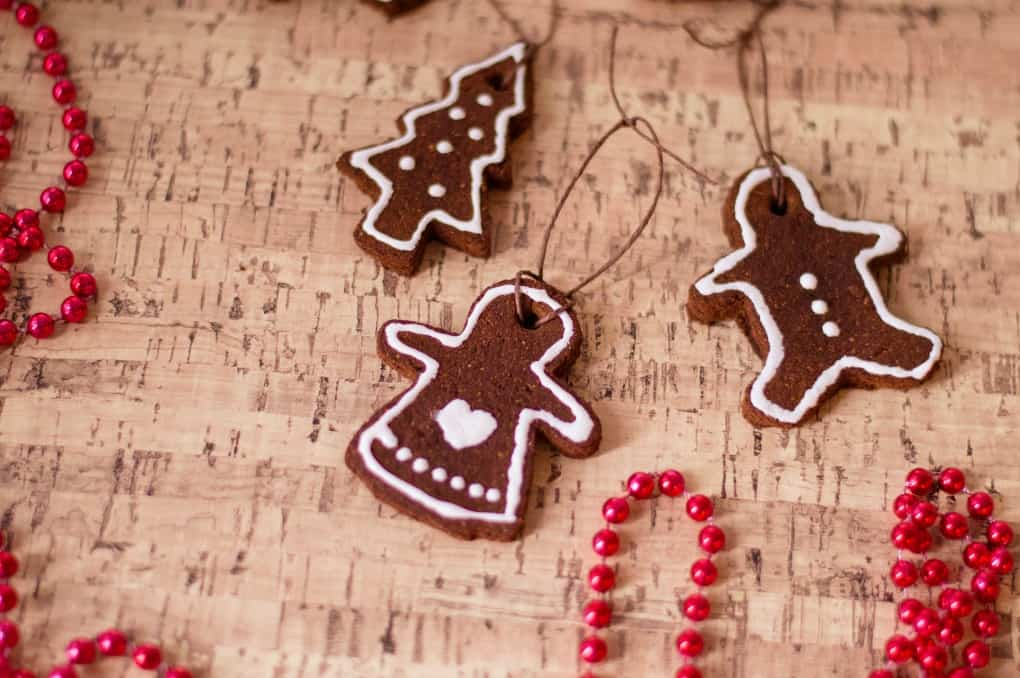 Cinnamon Ornaments on a corkboard with red beads.