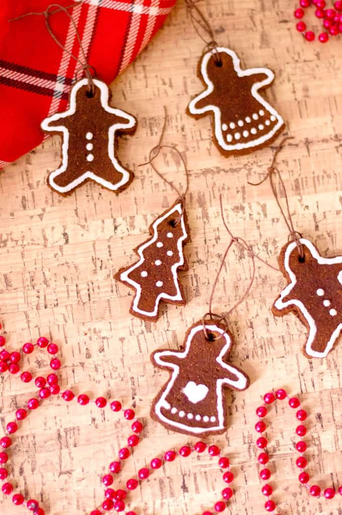 Cinnamon Ornaments on a cork board with red beads and plaid scarf