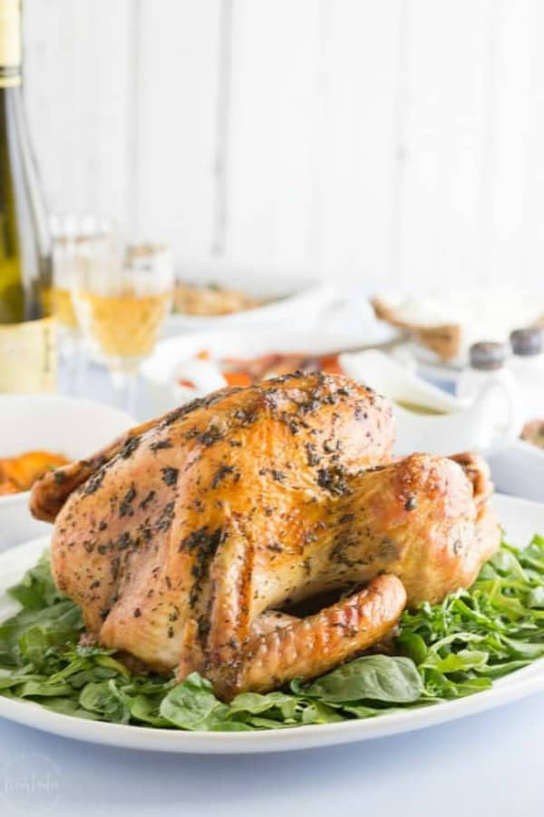 Roast turkey on a platter with greens