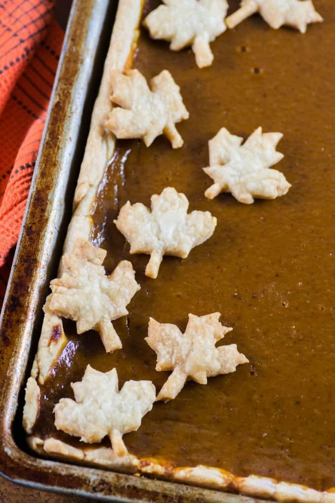 Pumpkin Slab Pie with pie crust maple leaves and orange towel