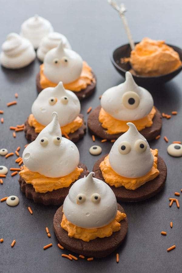 Meringue ghosts on top of cookies