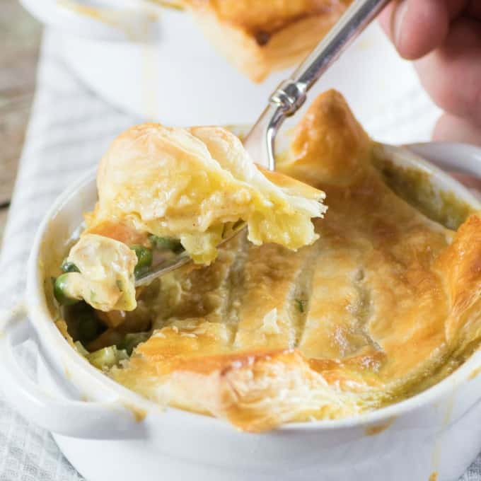 Curried Turkey Pot Pie in a ramekin and dished up with a fork