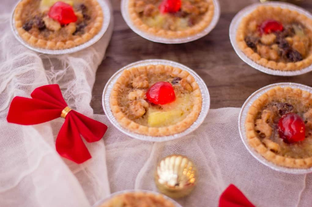 Holiday Mini Butter Tarts on a wooden board with decorations