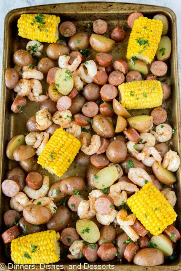 Shrimp, potatoes and corn on a sheet pan