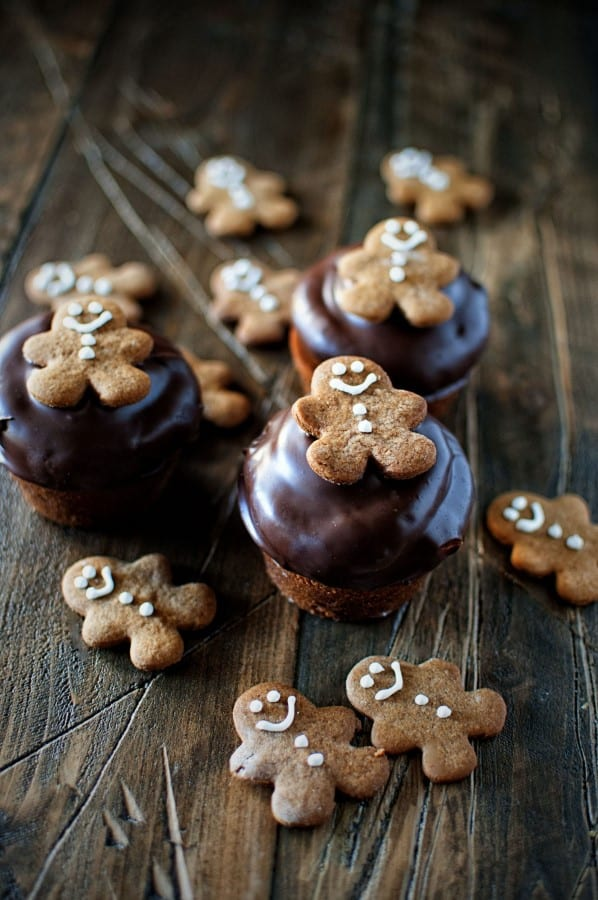 Chocolate Dipped Gingerbread Cupcakes on a wooden board.