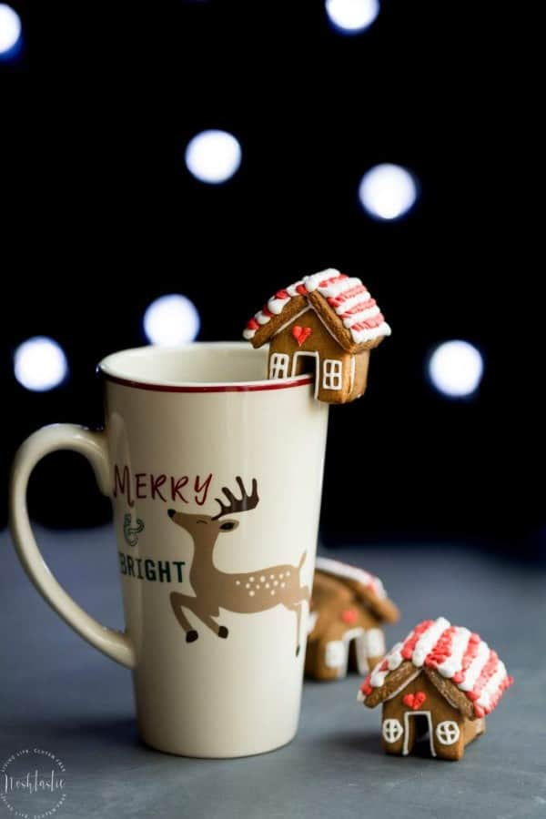 Mini Gingerbread Mug Topper on the side of a holiday mug.