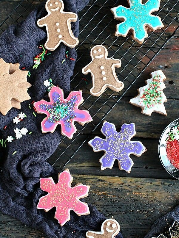 Assorted Neon Chocolate Christmas Cookies on a cooling rack with a black cloth.