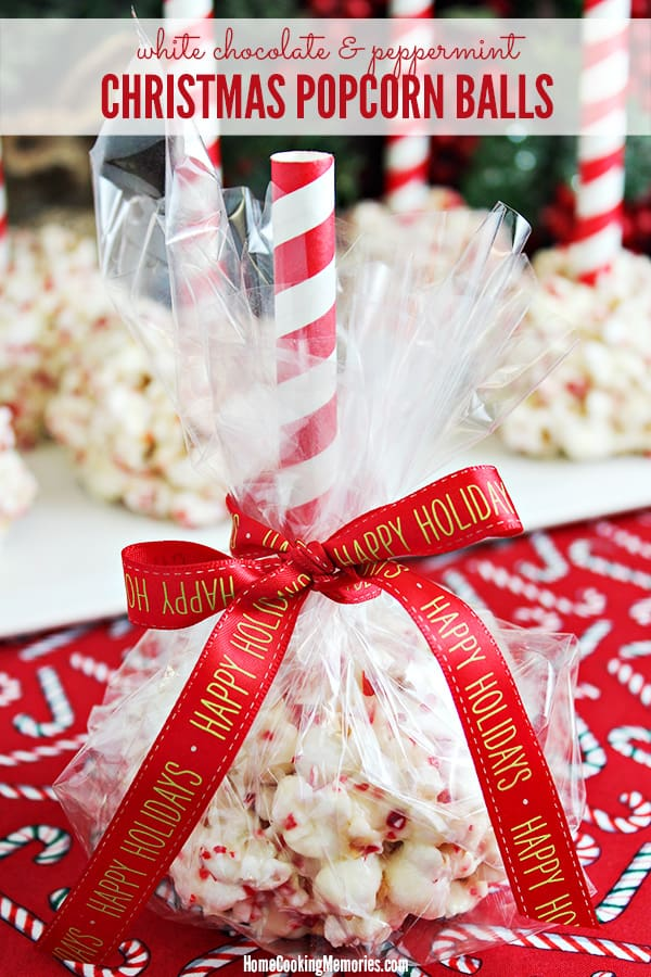 Christmas Popcorn Balls wrapped up in cello and tied with holiday ribbon.