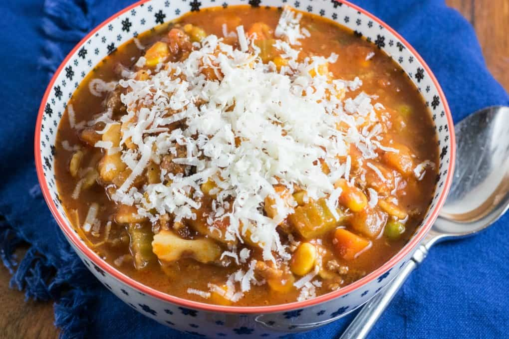 Bowl of minestrone soup topped with Parmesan cheese